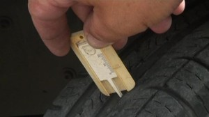 Rx Automotive offers new tire sales and install in St Charles IL. Image of how to use a depth gauge.